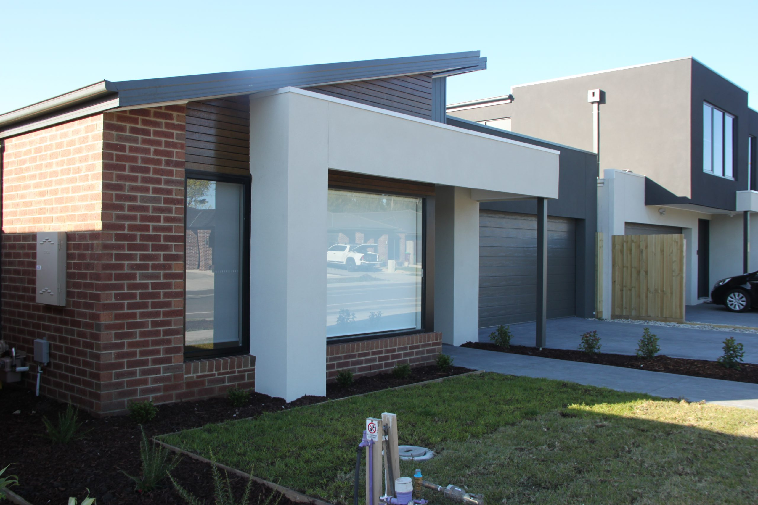 SIL ACC Fiorelli Front yard with grass and exterior of house